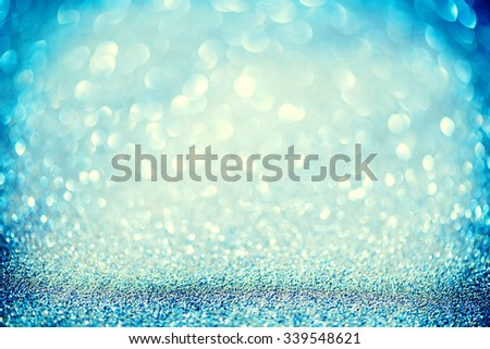 Christmas Blue Background. Golden Holiday glowing Abstract Glitter Defocused Background With Blinking Stars. Blurred Blue color Bokeh  - stock photo