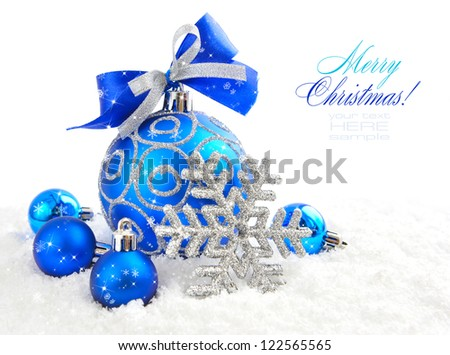 Christmas blue ball is with baubles on snow - stock photo