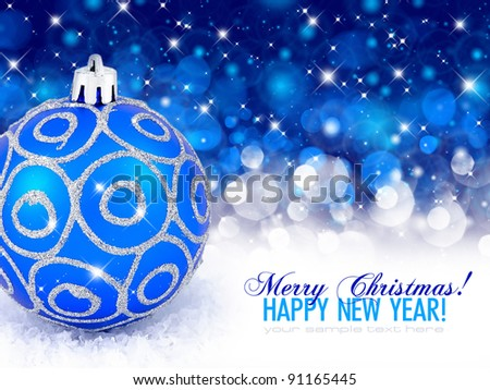 Christmas blue ball on a festive background - stock photo
