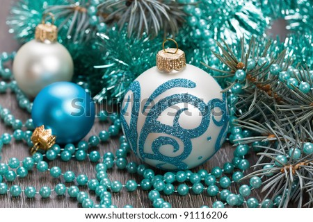 Christmas blue balls and beads decorations close-up shallow DOF - stock photo