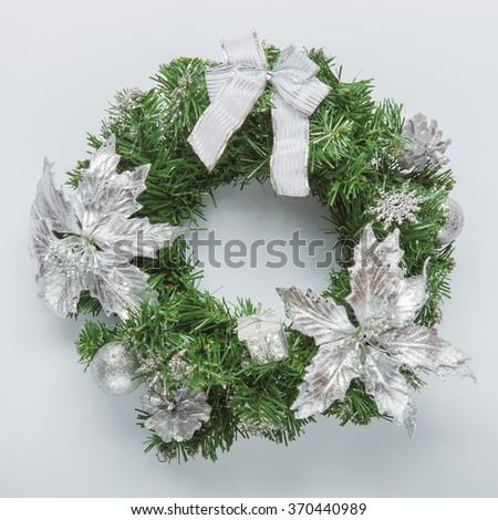Christmas blue wreath on white - stock photo