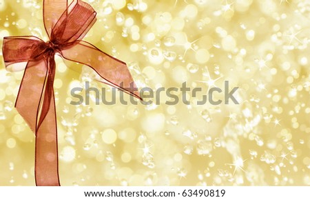 Christmas blur background tied with a bow of red ribbon - stock photo