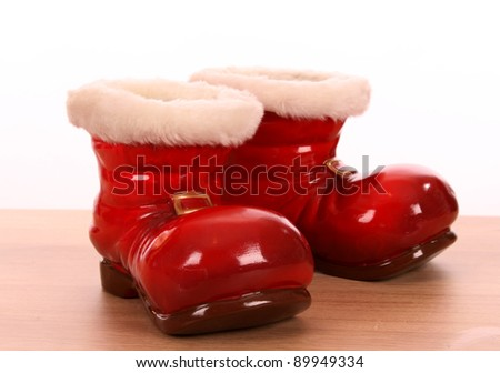 Christmas boots as flower pot - stock photo