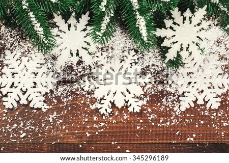Christmas border design on the wooden background - stock photo
