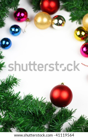 Christmas border of evergreen, ornaments,