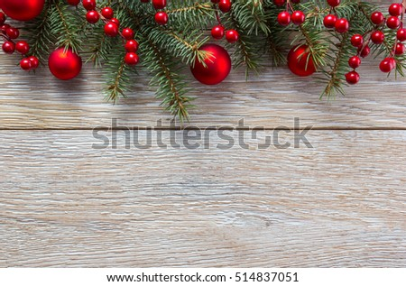 Christmas border on wooden plank background