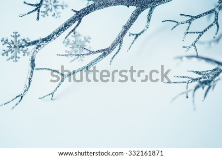 Christmas Border. Silver Branch and Metallic Snowflakes over Light Background. Selective Focus. Space for Text. Image Toned. - stock photo