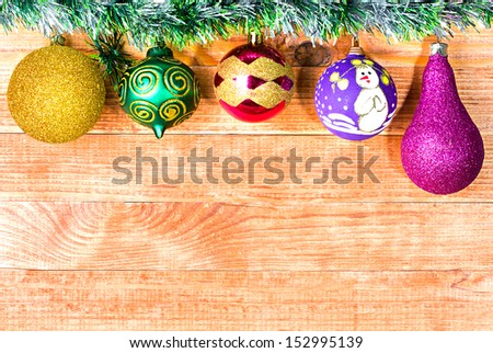 Christmas border with decoration, New Year's toys, on a wooden background - stock photo