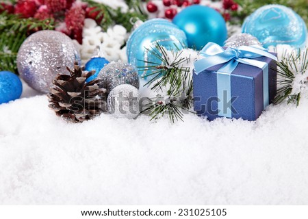 Christmas border with decorations, pine cone and gift on the snow. Space for copy. - stock photo