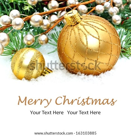 Christmas border with golden ornaments and snow  - stock photo