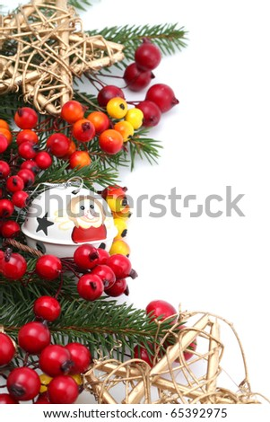 Christmas border with jingle bell, stars and berries isolated on white background. Shallow dof - stock photo