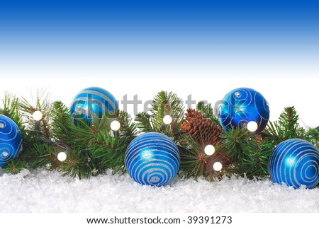Christmas border with lights, blue ornaments and snow. - stock photo