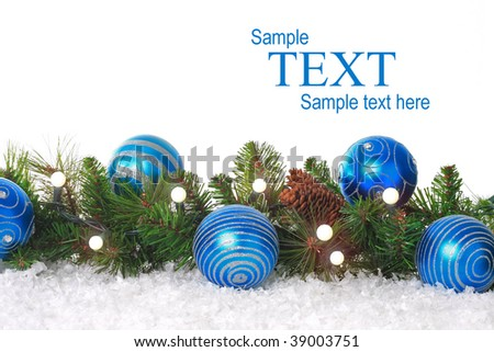 Christmas border with lights, blue ornaments and snow. Add your own text. - stock photo