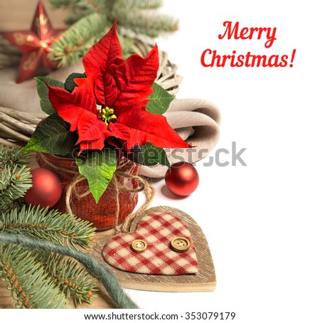 Christmas border with poinsettia and Christmas decorations. Space for your text on white background.