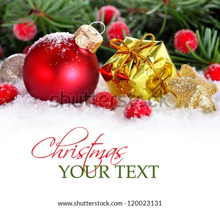 Christmas border with red bauble, golden present and snow - stock photo
