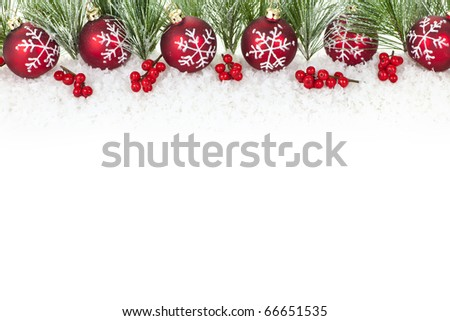 Christmas border with red ornaments and pine branches - stock photo