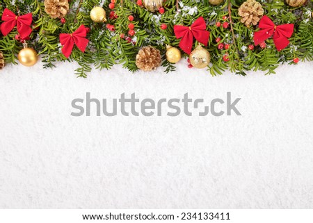 Christmas border with traditional decorations on the snow. Space for copy. - stock photo