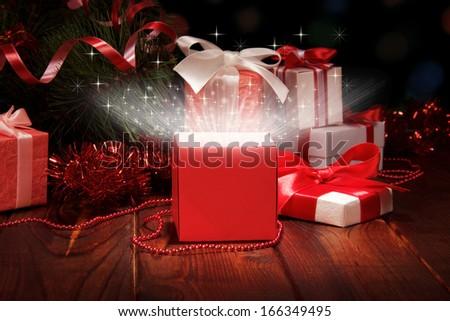 Christmas box and Christmas tinsel - stock photo