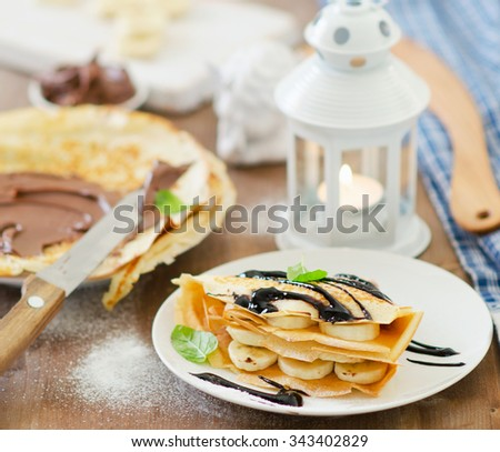 Christmas breakfast. Crepes with chocolate cream. Selective focus