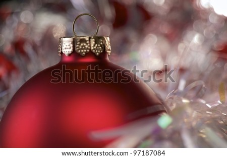Christmas Bulb in Shiny Reflective Background - stock photo