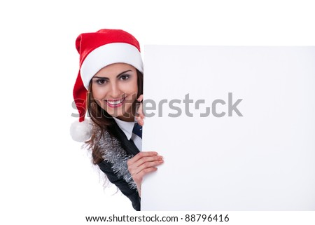 Christmas businesswoman in santa hat with blank billboard on white background - stock photo