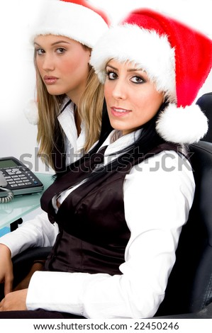 christmas businesswomen looking at camera with white background - stock photo