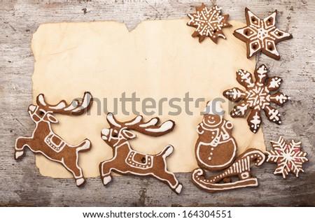 Christmas cake in the shape of a deer, Santa's sleigh, snowman - stock photo