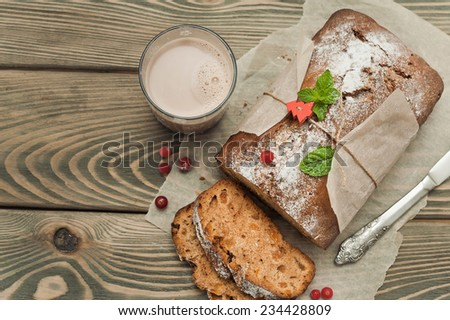 Christmas cake on wooden background - stock photo