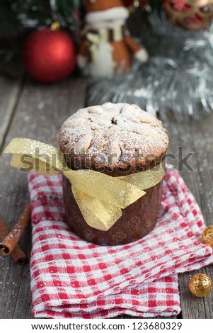 Christmas cake with almonds on the wooden table (panettone) - stock photo