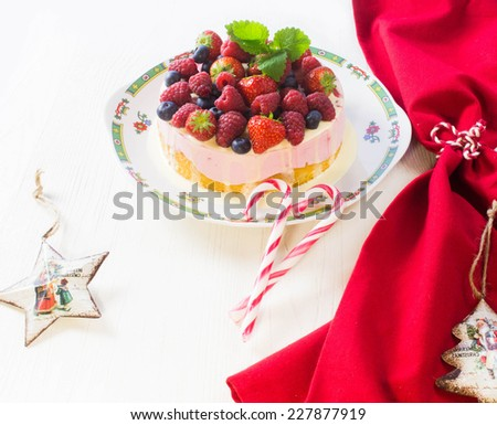 Christmas cake with Berries - stock photo