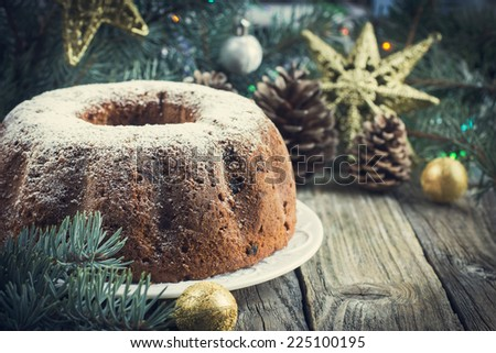christmas cake with christmas decoration, toned