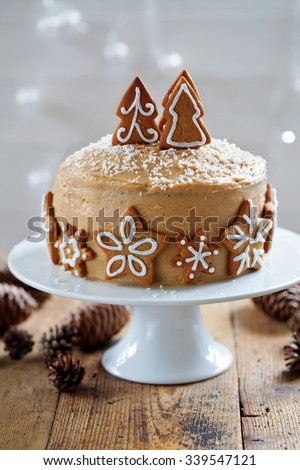 Christmas cake with gingerbread decorations - stock photo