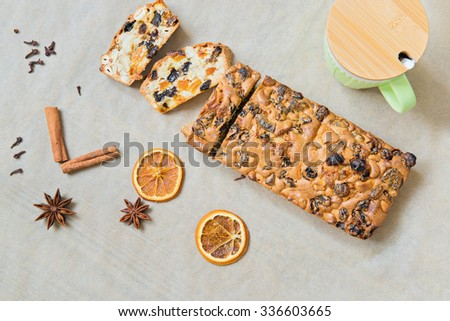 Christmas cake with mug on the baking paper, top view - stock photo