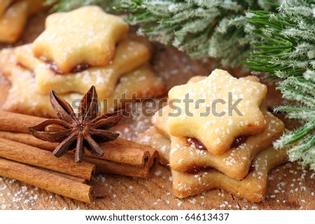 Christmas cakes on brown wooden background - stock photo