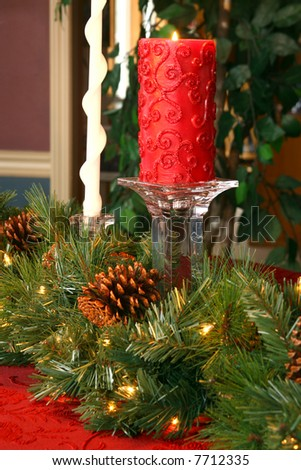 Christmas candle and greenery - stock photo