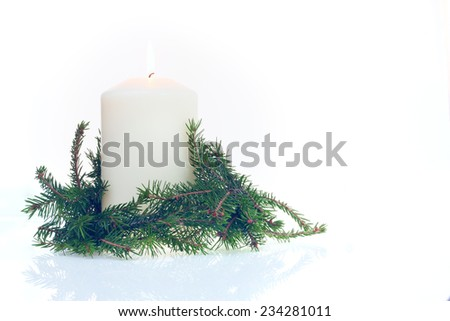 Christmas Candle and pine branch on white background - stock photo