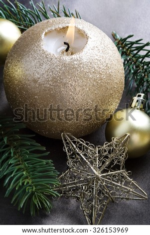 Christmas candle and vintage baubles. - stock photo