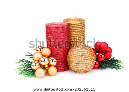Christmas candle, balls and  fir tree branches isolated on white background. - stock photo