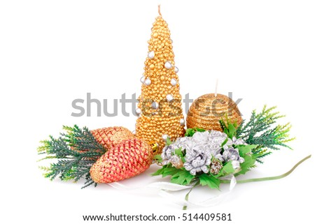 Christmas candle, flowers and toys isolated on white background.