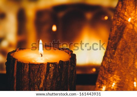 Christmas Candle in a Warm Interior - stock photo