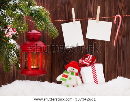 Christmas candle lantern, gift box and blank photo frames - stock photo