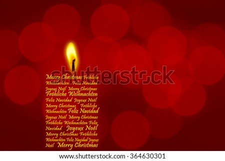 """Christmas Candle """"Merry Christmas""""  in four languages - stock photo"""