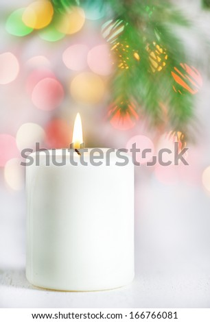 Christmas candle with lights on the background - stock photo