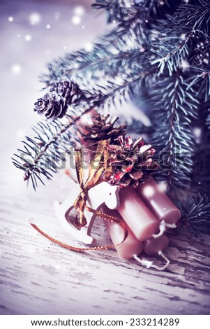 Christmas  candles and wooden horse with fur and pine cone  in vintage style - stock photo