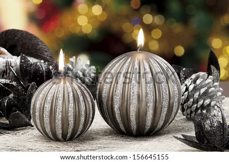 Christmas candles,baubles on background defocused lights - stock photo