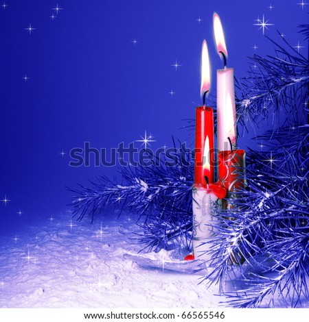 Christmas Candles Burning in Pine Tree and Snow - stock photo