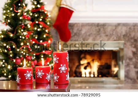 Christmas candles by the Christmas trees and fire - stock photo