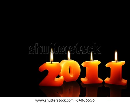 Christmas candles for 2011 year isolated on black background - stock photo