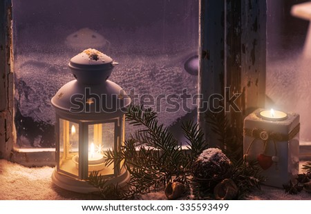 Christmas - candles glow in the steamy window - stock photo