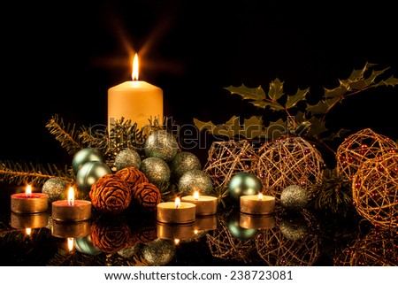 Christmas candles on a black background - stock photo